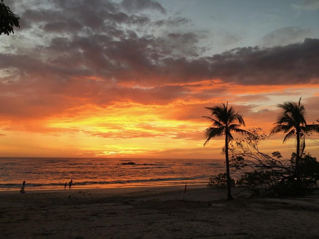 sun setting on costa rican beach