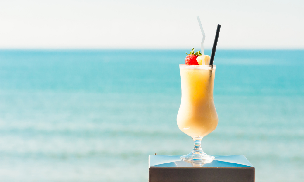 pina colada sitting on the beach