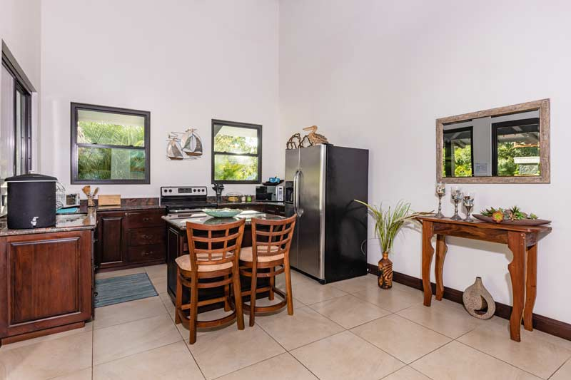pura vida house dining room in villa room