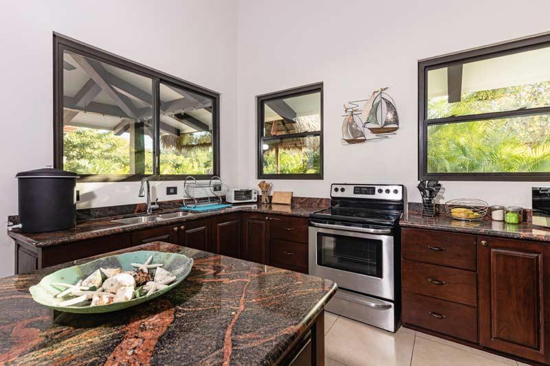 pura vida house room kitchen