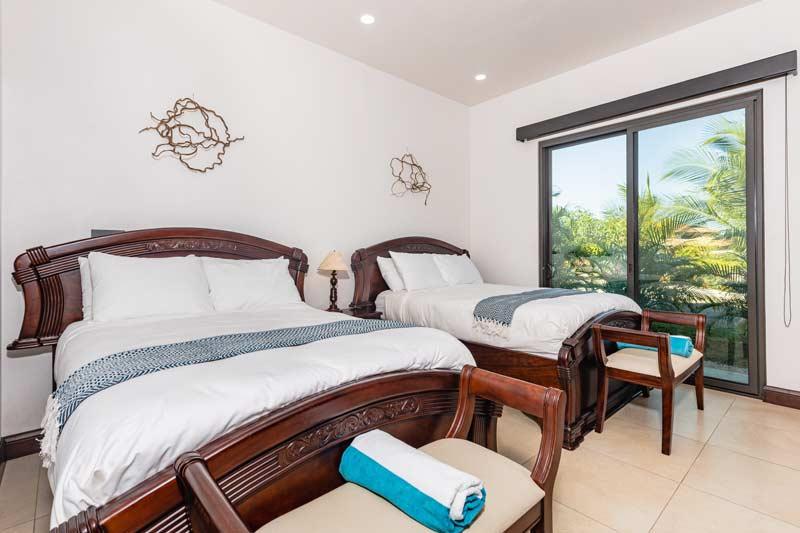pura vida house two queen bed bedroom